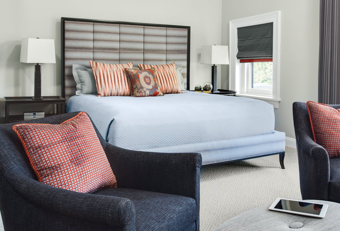In the master bedroom, a Century bed features a geometric quilted headboard.