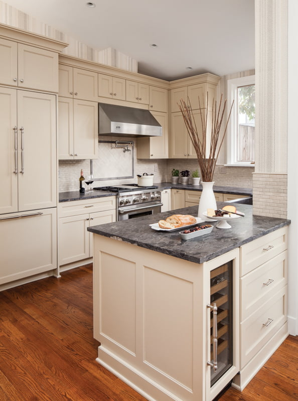 Custom cabinets in the kitchen are paired with black-granite countertops.