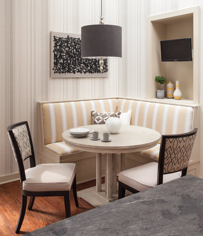 A banquette and dining chairs provide casual seating in the breakfast nook.