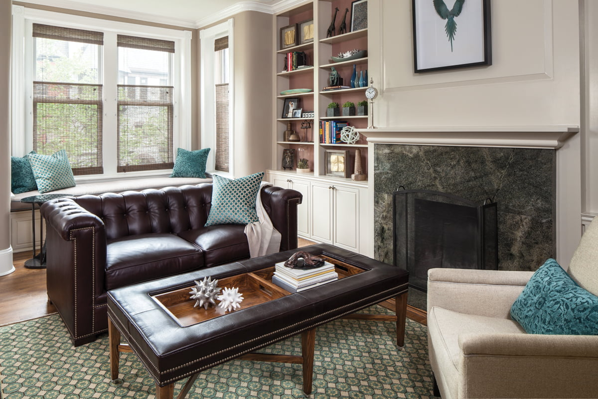 A tufted-leather sofa and ottoman table by Hickory Chair offer room to relax in the office.