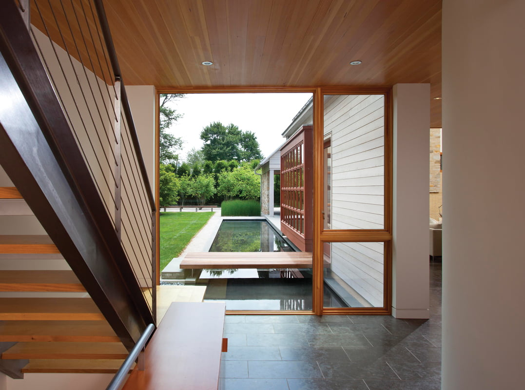 The reflecting pool and its wooden bridge are visible from the front hall. © SCOTT SMITH